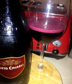 Purple frothy Lambrusco foam